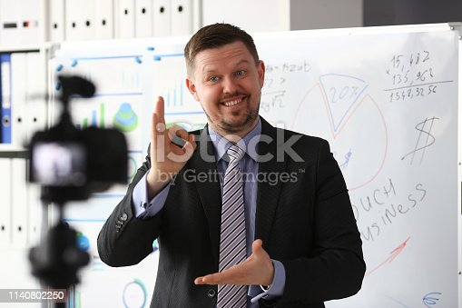 815359538 istock photo Male in suit and tie show confirm sign 1140802250