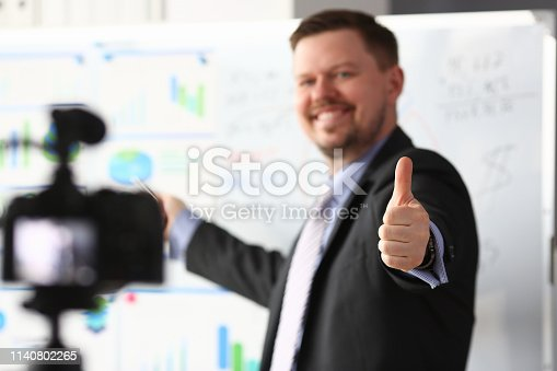 815359538 istock photo Male in suit and tie show confirm sign 1140802265