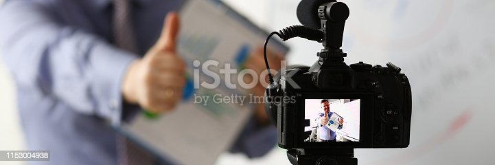 815359538 istock photo Male in suit and tie show confirm sign 1153004938