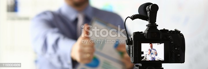 815359538 istock photo Male in suit and tie show confirm sign 1153004939