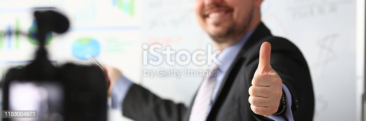 815359538 istock photo Male in suit and tie show confirm sign 1153004971