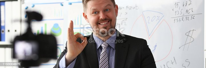 815359538 istock photo Male in suit and tie show confirm sign 1153004975