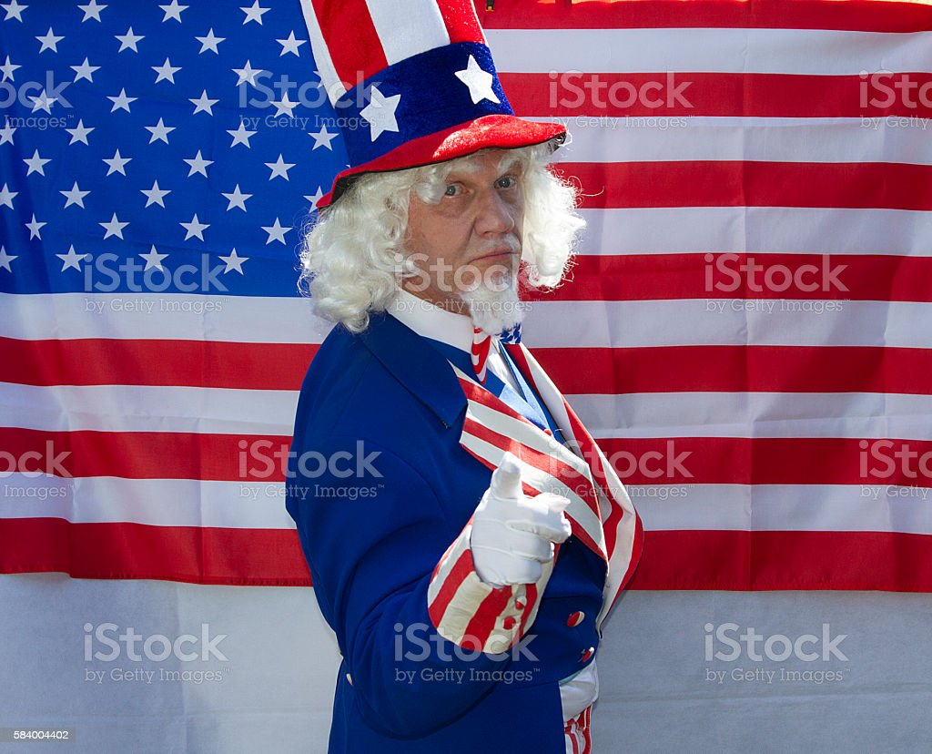 Male in Uncle Sam costume pointing stock photo