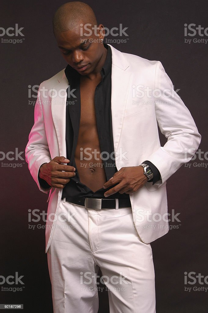 male in white suit stock photo