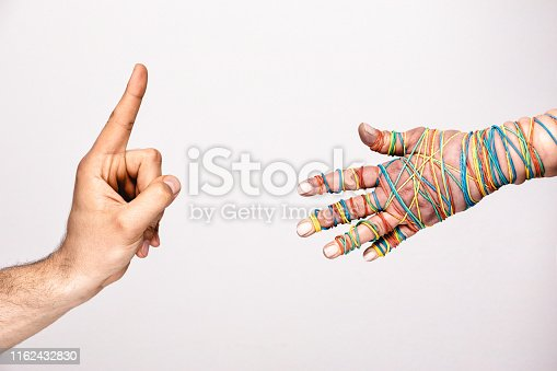 istock Male index finger up gesture woman offering hand for a handshake - Communication two people concept. Boss employee relationship hand gestures against white background, with negative space - Rejection. 1162432830