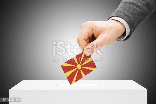 935056316istockphoto Male inserting flag into ballot box - Republic of Macedonia 524820159