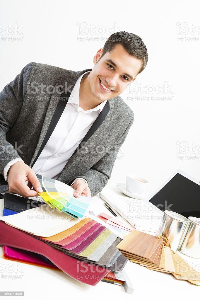 male interior designer at his desk royalty-free stock photo
