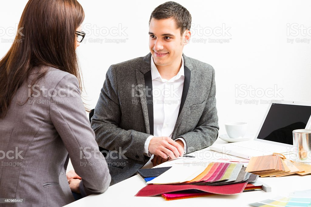 male interior designer with client royalty-free stock photo