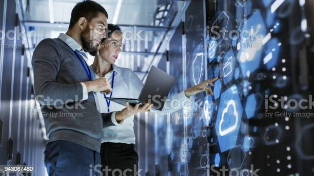 Male it specialist holds laptop and discusses work with female server picture id943067460?b=1&k=6&m=943067460&s=612x612&h=gxntiv6kl3oao9wzlokw19qgaqgnqoy3uibaay4t2ym=