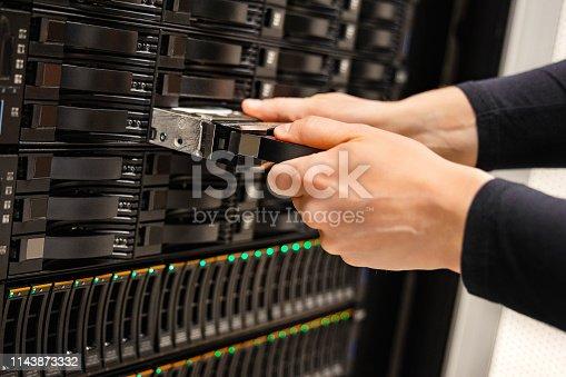 istock Male IT Technician Replacing Server Drive In San 1143873332