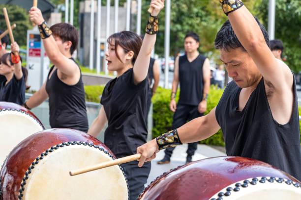 Male japanese drumer playing Taiko - Kumi-daiko performance in Hiroshima, Japan. stock photo