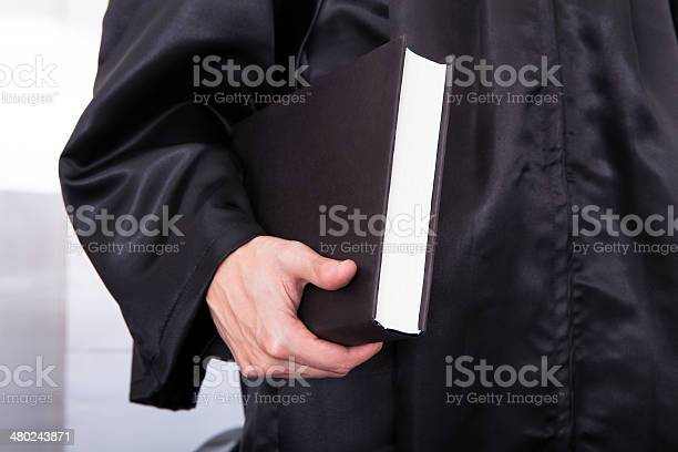 Male Judge Holding Law Book Stock Photo - Download Image Now