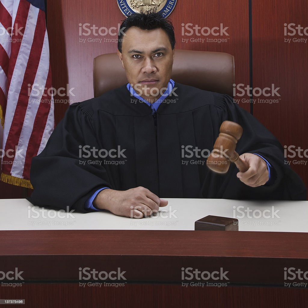 Male Judge With Gavel in Courtroom stock photo