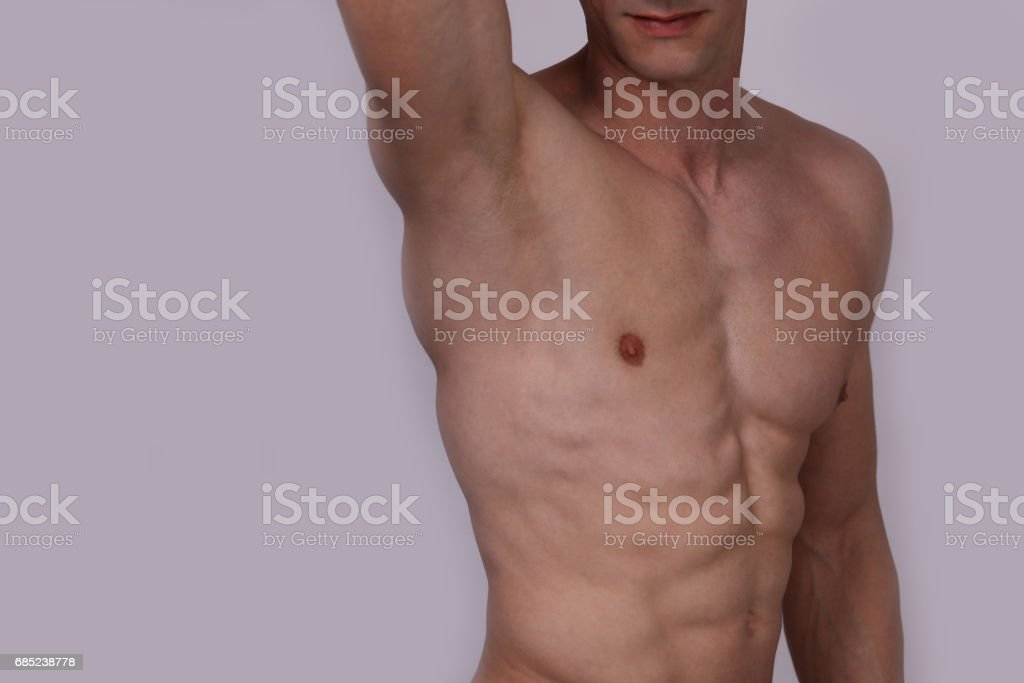 Male laser epilation. Attractive man torso hair removal. Close up on perfect male body, muscles foto de stock royalty-free