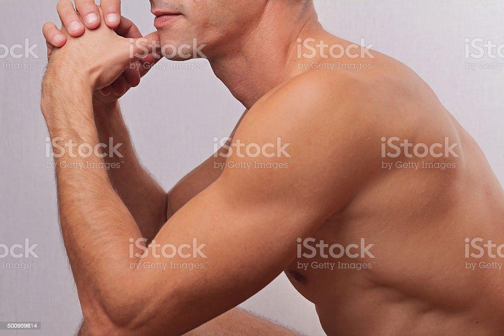 Male laser epilation. Attractive man torso hair removal. stock photo
