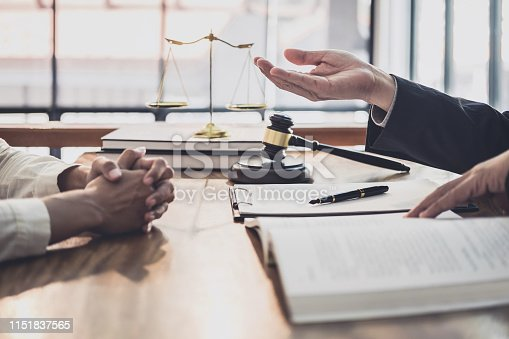 istock Male lawyer or judge consult having team meeting with Businesswoman client, Law and Legal services concept 1151837565