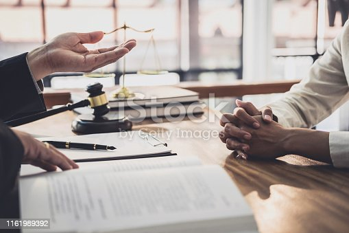 istock Male lawyer or judge consult having team meeting with Businesswoman client, Law and Legal services concept 1161989392