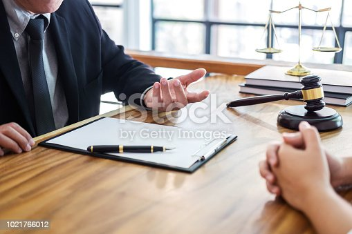 istock Male lawyer or judge consult having team meeting with client, Law and Legal services concept 1021766012