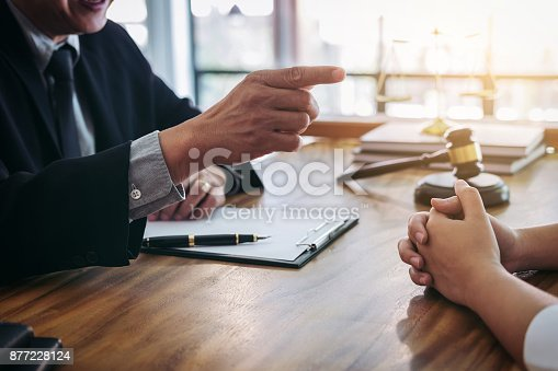 istock Male lawyer or judge consult having team meeting with client, Law and Legal services concept 877228124