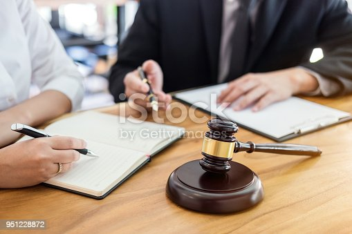 istock Male lawyer or judge consult having team meeting with client, Law and Legal services concept 951228872