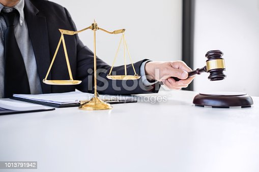 941906652 istock photo Male lawyer or judge working with Law books, gavel, report the case on table in modern office, Law and justice concept 1013791942