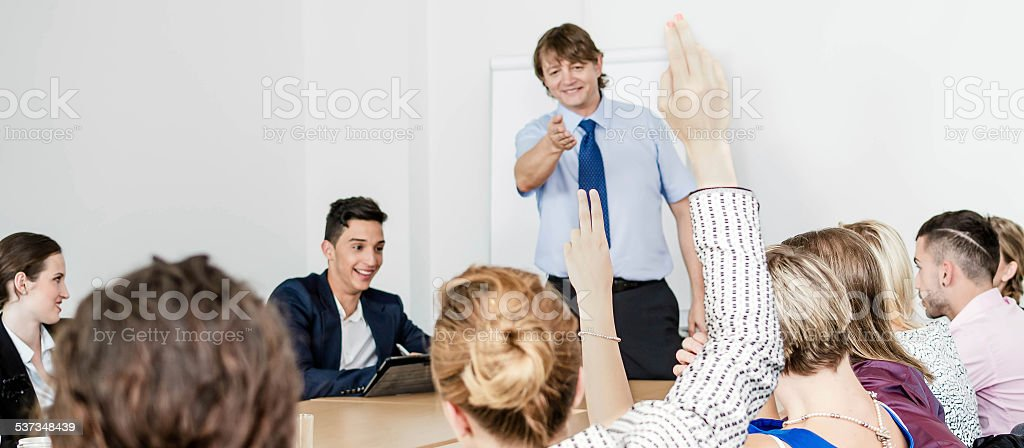 Male lecturer on business seminar stock photo