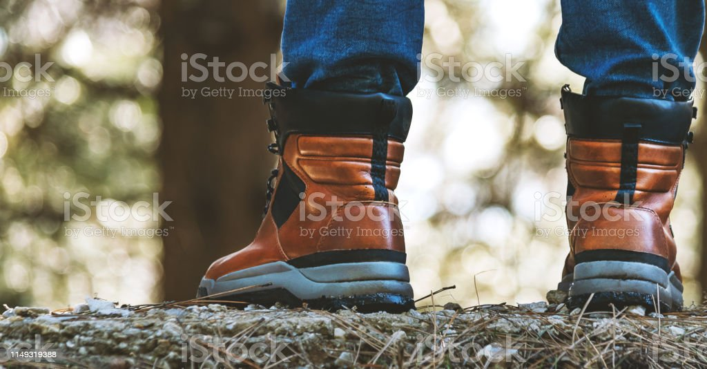 Male Legs With Leather Boots Close Up View In Forest