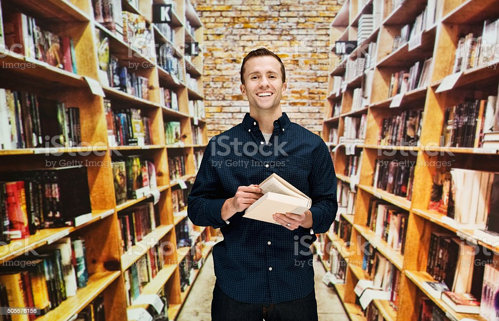 Male librarian in library stock photo