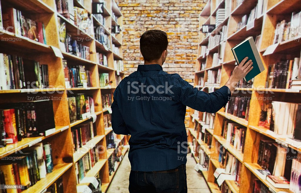 Male librarian working in library stock photo