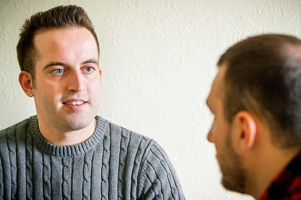 Male Life Coach talking with his Client stock photo