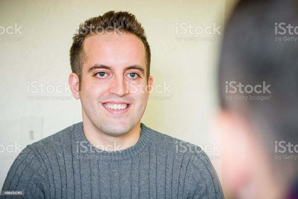 Male Life Coach talking with, listening to his Client stock photo