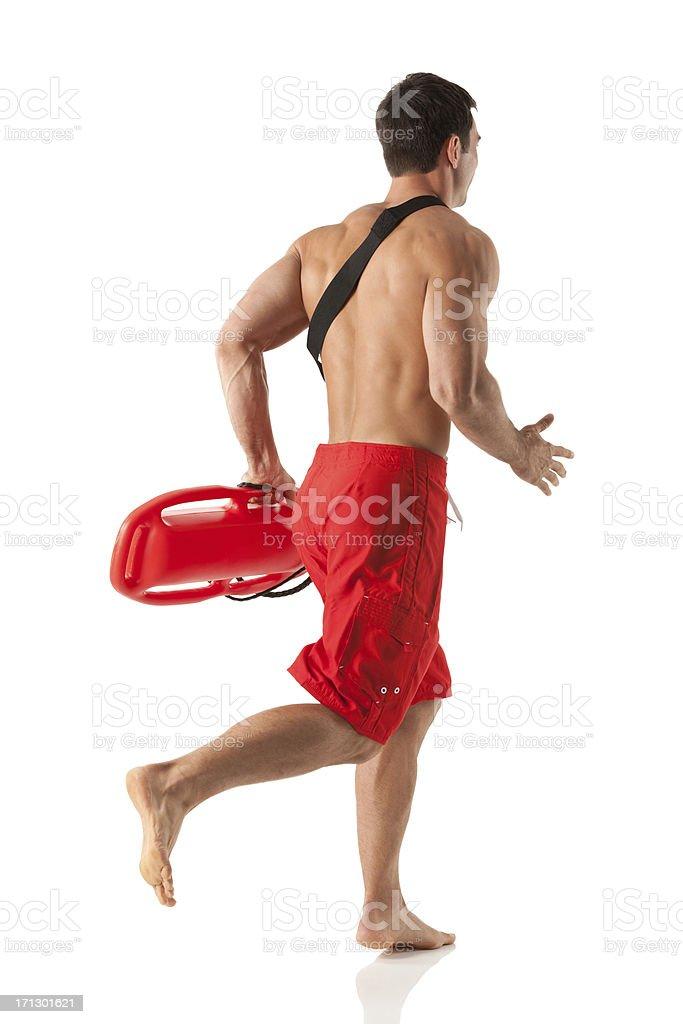 Male lifeguard running royalty-free stock photo