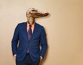 Male alligator in office clothing suit and shirt, dangerous business man concept- mixed media