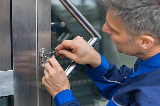 Male Lockpicker Fixing Door Handle At Home Mature Male Lockpicker Fixing Door Handle At Home locksmith stock pictures, royalty-free photos & images