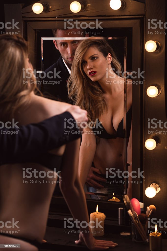 Male lover undressing a girl stock photo