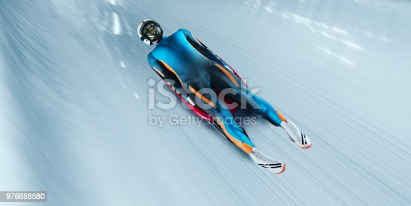 Male Luger glides on the sleigh in professional Luge Track on competition. Sportsman dressed in a suit for sledge sports and protective helmet