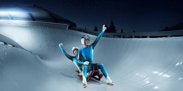 male lugers couple rejoice at victory on luge track - sports championship stock photos and pictures