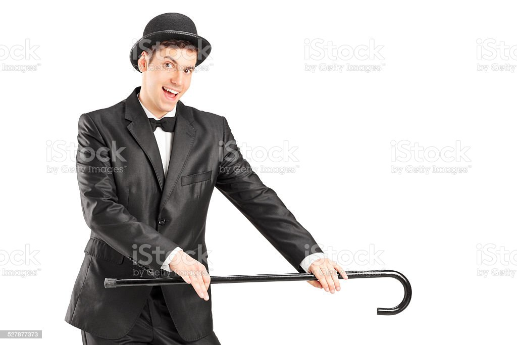 Male magician holding a cane stock photo