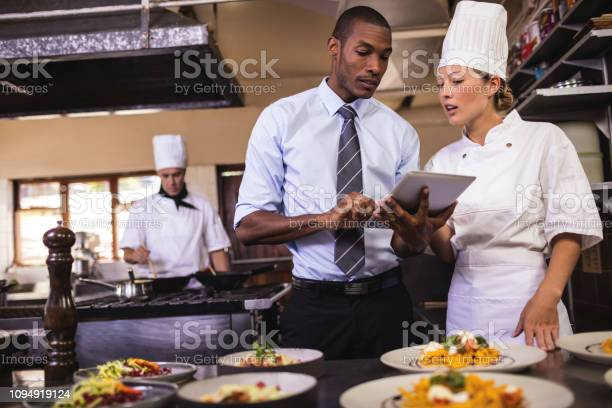 Male manager and female chef using digital tablet in kitchen picture id1094919124?b=1&k=6&m=1094919124&s=612x612&h=v3 zqpq2o7 1hhbfszli6lvwors oaeimo3oriawbto=
