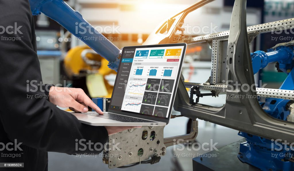 Male manager hand laptop for check real time production monitoring system application in smart factory industrial. Automated conveyor systems for package transfer machine Industry 4.0 and iot concept. stock photo