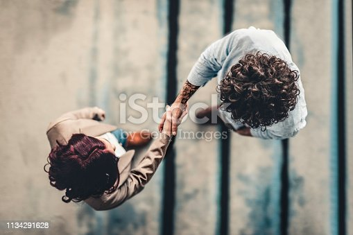 istock Male Manager Shaking Hands With Female Applicant 1134291628