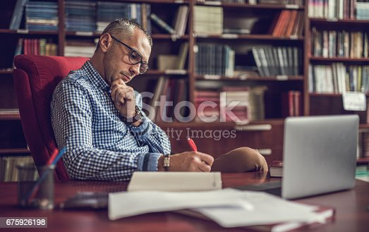 istock Male manager taking notes in home office. 675926198