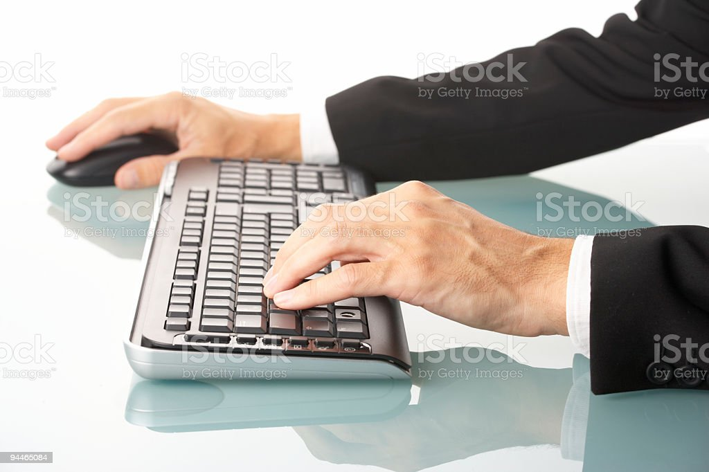 male manager using wireless keyboard and mouse royalty-free stock photo