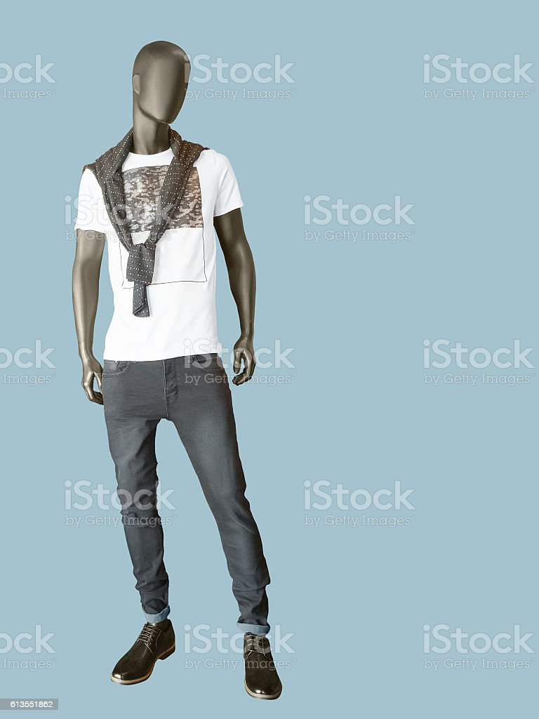 Male mannequin dressed in t-shirt and gray jeans stock photo