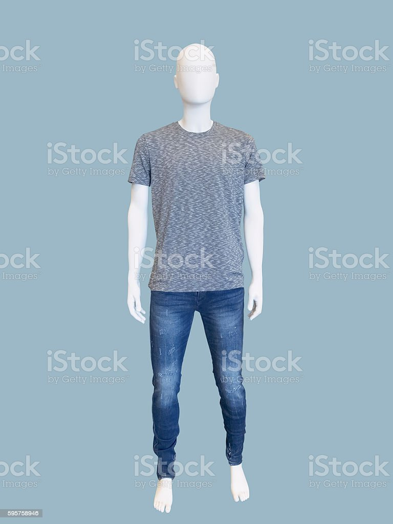 Male mannequin dressed in t-shirt and jeans. stock photo