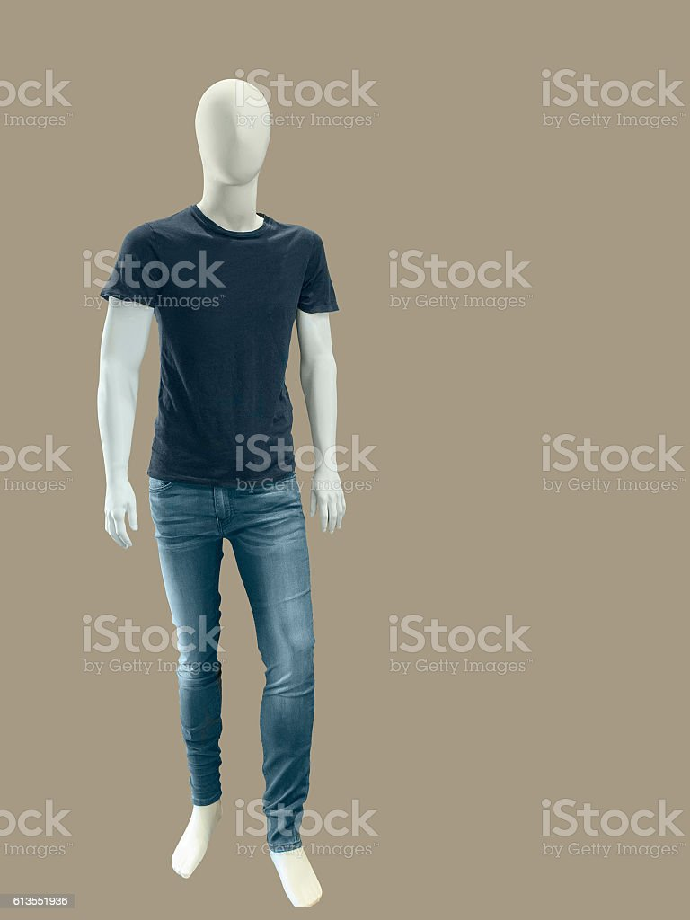 Male mannequin dressed in t-shirt and jeans stock photo