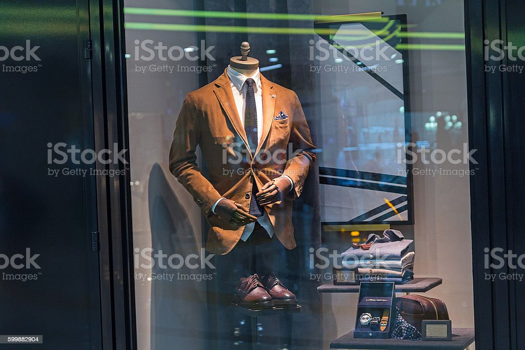 Male mannequin wearing a suit and accessories. Sale stock photo