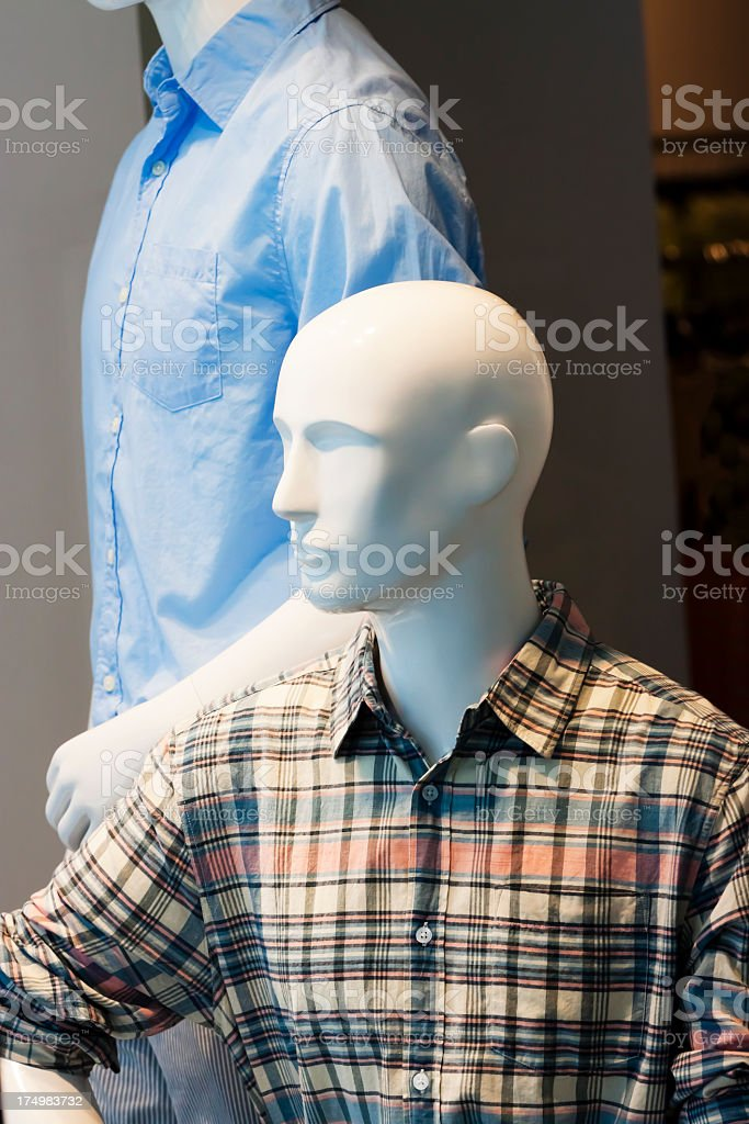 Male mannequins with checkered and blue shirts royalty-free stock photo