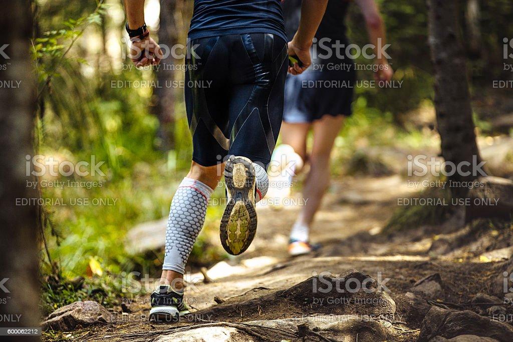 male marathon runner running woods stock photo