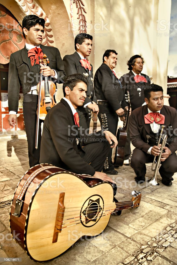 Male Mariachi Band Posing on Cobble Streets Outside stock photo